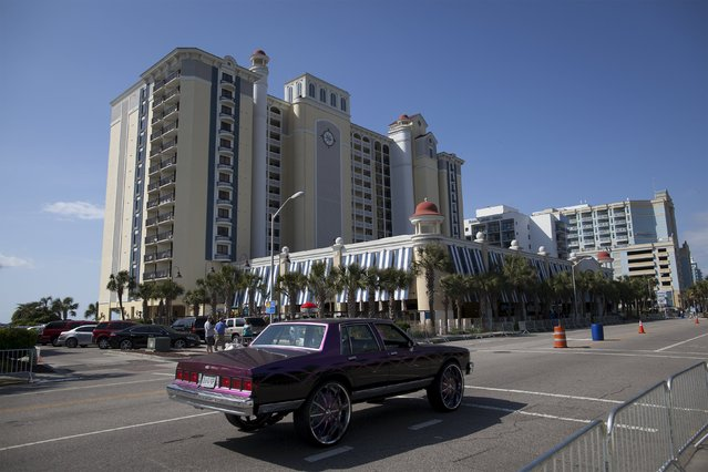 A customized car drives down South Ocean Boulevard during the 2015 Atlantic Beach Memorial Day BikeFest in Myrtle Beach, South Carolina May 24, 2015. (Photo by Randall Hill/Reuters)