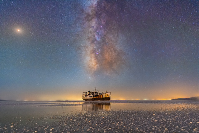 Sharafkhaneh port and lake Urmia. Masoud Ghadiri (Iran). The summer Milky Way is very prominent in this photo. On the galaxy zone, Saturn is located besides the Lagoon nebula. On the right of the horizon, you can see the extreme light pollution of Urmia, which is caused by ever-increasing city development. (Photo by Masoud Ghadiri/National Maritime Museum)