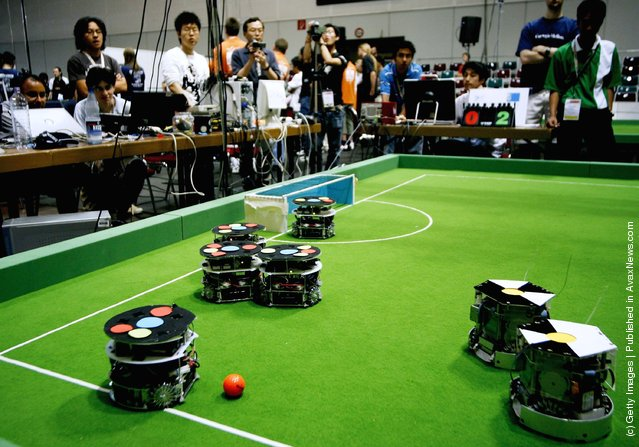 Small size robots in action during the Robocup