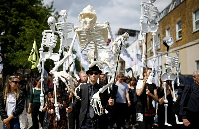 Extinction Rebellion activists march through East London, Britain on July 13, 2019. Extinction Rebellion are a socio-political movement which uses civil disobedience and nonviolent resistance to protest against climate breakdown, biodiversity loss, and the risk of social and ecological collapse. (Photo by Henry Nicholls/Reuters)