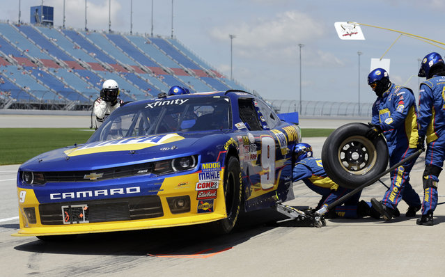 Chase Elliott (9) makes a pit stop during the NASCAR Xfinity series auto race at Chicagoland Speedway, Sunday, June 21, 2015, in Joliet, Ill. (AP Photo/Nam Y. Huh)