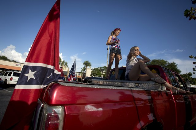 "Women stand on a pick up truck as they listen to instructions for the ""Ride for Pride"" impromptu event to show support for the Confederate flag in Brandon, Hillsborough County, June 26, 2015. (Photo by Carlo Allegri/Reuters)"