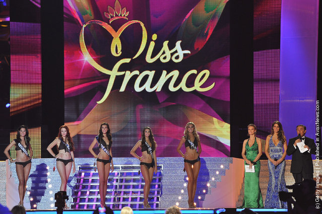 Miss France contestants stand on stage during Miss France Beauty pageant 2012