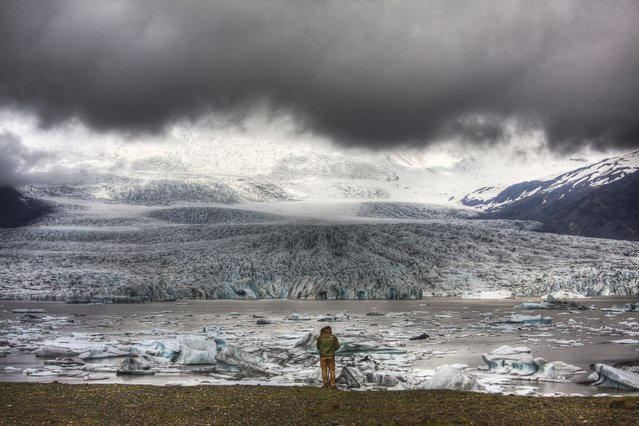 "Feng's son is dwarfed by the looming majesty of a glacier at Fjallsárlón. ""I stood there for a while, contemplating and admiring. I wanted to remember that moment forever"", says Feng. Fjallsárlón Glacier, Iceland. (Photo by Candy Feng/Smithsonian.com)"