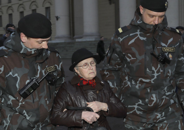 Police officers detain opposition activist, Nina Baginskaya, center,  prior to a protest in Minsk, Belarus, Friday, March 31, 2017. Four people have been detained in Minsk during an attempt to protest against political repression. (Photo by v/AP Photo)
