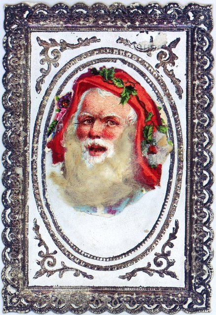 1878:  A Victorian Christmas greetings card with the bearded face of Santa Claus