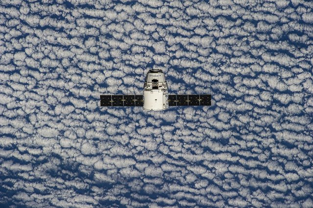 This photo provided by NASA is one of an extensive series of still photos documenting the arrival and ultimate capture and berthing of the SpaceX Dragon capsule at the International Space Station, as photographed by the Expedition 39 crew members onboard the orbital outpost Sunday April 20, 2014. (Photo by AP Photo/NASA)