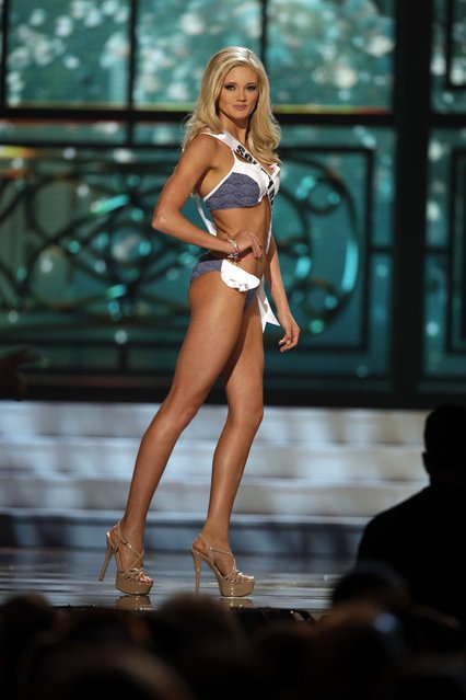 Miss South Dakota, Lexy Schenk, competes in the bathing suit competition during the preliminary round of the 2015 Miss USA Pageant in Baton Rouge, La., Wednesday, July 8, 2015. (Photo by Gerald Herbert/AP Photo)