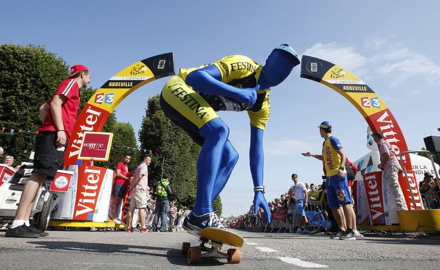 A performer of a Tour de France sponsor rides a skateboard at the start of the 191.5-km (118.9 miles) 6th stage of the 102nd Tour de France cycling race from Abbeville to Le Havre, France, July 9, 2015. (Photo by Eric Gaillard/Reuters)