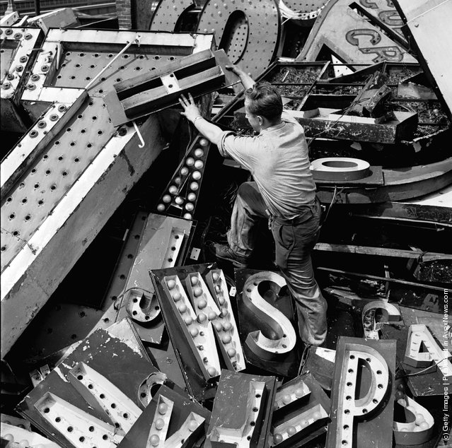 1950: Old signs reclaimed by neon sign making company Art-Craft Strauss. Many of their signs adorn New York's Times Square