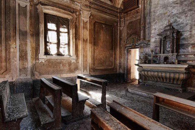 An abandoned chapel in a quiet, tiny village in Italy. The only sound you hear is the doves cooing while they leave their traces on the furniture. (Photo by Vincent Jansen)