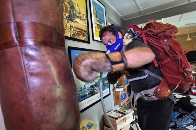 This picture taken on April 22, 2017 shows Brooks Entwisle performing hypoxic boxing training, in preparation for his attempt to summit Mount Everest, in Singapore. For decades, the dream of reaching the summit of Mount Everest has required at least two months on the mountain doing a series of acclimatisation rotations to get used to the harsh low-oxygen environment at the top of the world. Now pre-acclimatisation, which has been at the fringes of the climbing world for several years, is gaining traction, dividing the community between those who see it as yet another tool of modern mountaineering and purists who dismiss it as a gimmick. (Photo by Roslan Rahman/AFP Photo)