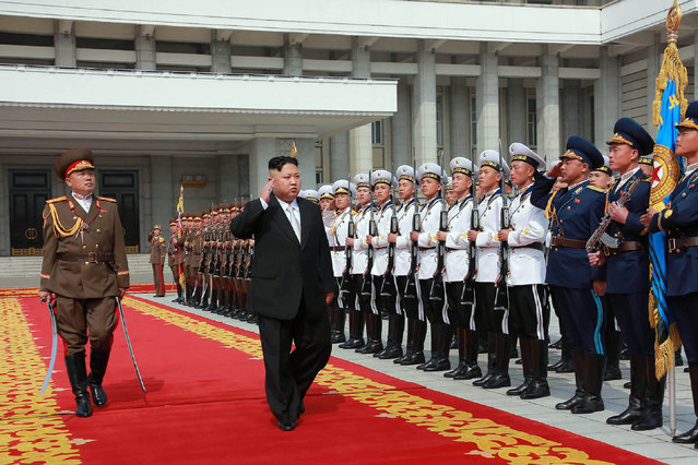 This April 15, 2017 picture released from North Korea's official Korean Central News Agency (KCNA) on April 16, 2017 shows North Korean leader Kim Jong-Un (C) arriving for a military parade in Pyongyang marking the 105th anniversary of the birth of late North Korean leader Kim Il-Sung. (Photo by AFP Photo/Stringer)