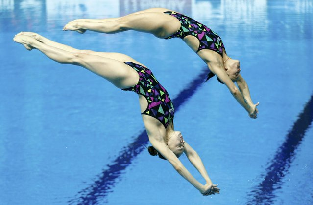 Russia's Nadezhda Bazhina and Kristina Ilinykh dive during the women's synchronized 3m springboard final at the Aquatics World Championships in Kazan, Russia, July 25, 2015. (Photo by Hannibal Hanschke/Reuters)