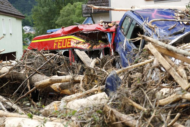 A damaged fire-engine lies amongst debris following floods in the town of Braunsbach, in Baden-Wuerttemberg, Germany, May 30, 2016. (Photo by Kai Pfaffenbach/Reuters)