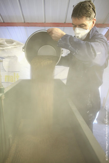 Jimmy Kennedy, empties malt at Edradour distillery on March 26, 2012 in Pitlochry, United Kingdom