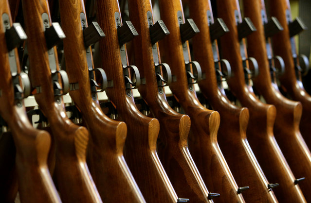 Newly assembled rifles are placed on a stand in the Ceska Zbrojovka weapons factory in Uhersky Brod, Czech Republic, May 27, 2016. (Photo by David W. Cerny/Reuters)