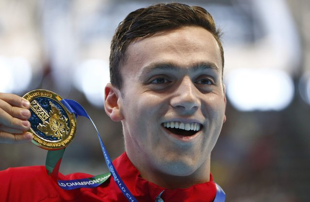 Britain's James Guy celebrates with his gold medal after winning the men's 200m freestyle final at the Aquatics World Championships in Kazan, Russia, August 4, 2015. (Photo by Hannibal Hanschke/Reuters)