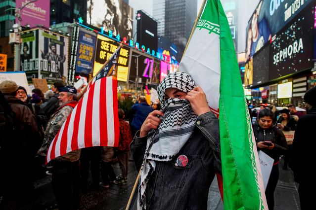 A man covers his face as people take part in an anti-war protest amid increased tensions between the United States and Iran at Times Square in New York, U.S., January 4, 2020. (Photo by Eduardo Munoz/Reuters)