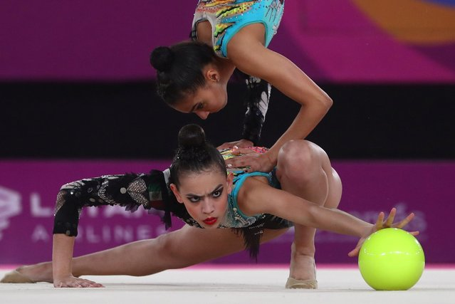 Team Mexico competes in the five balls during the rhythmic gymnastics group final at the Pan American Games in Lima, Peru, Sunday, August 4, 2019. Mexico won the gold medal. (Photo by Pilar Olivares/Reuters)