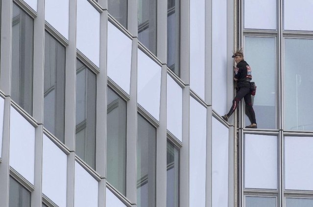 Alain Robert Climbs The First Tower In Paris