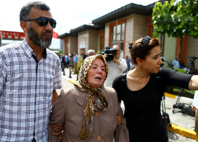 Sacide Bugda, mother of Abdulhekim Bugda who was one of the victims of  yesterday's blast at Istanbul Ataturk Airport, is comforted by her relatives as she walks to the front of a morgue in Istanbul, Turkey, June 29, 2016. (Photo by Osman Orsal/Reuters)