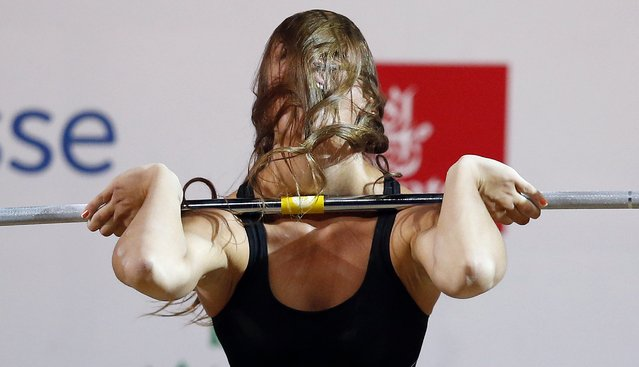 Marie-Julie Malboeuf of Canada lifts during the women's 58kg weightlifting competition at the 2014 Commonwealth Games in Glasgow, Scotland, July 26, 2014. (Photo by Phil Noble/Reuters)