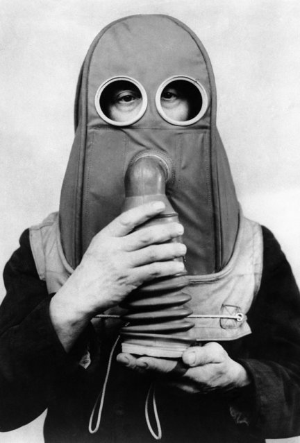 This is the newest anti-gas helmet, designed for persons who cannot wear any ordinary type gas mask shown in England, February 16, 1941. (Photo by AP Photo)
