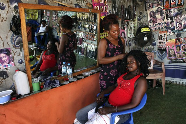 A woman getting her hair done at a salon in Juba. Haircare is a vital source of jobs for women, who make up a large slice of the informal economy on the poorest continent. (Photo by Andreea Campeanu/Reuters)