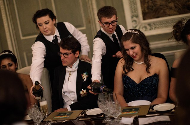 Debutantes and their escorts sit down to dinner at Leeds Castle during the Queen Charlotte's Ball on September 9, 2017 in Maidstone, England. (Photo by Jack Taylor/Getty Images)