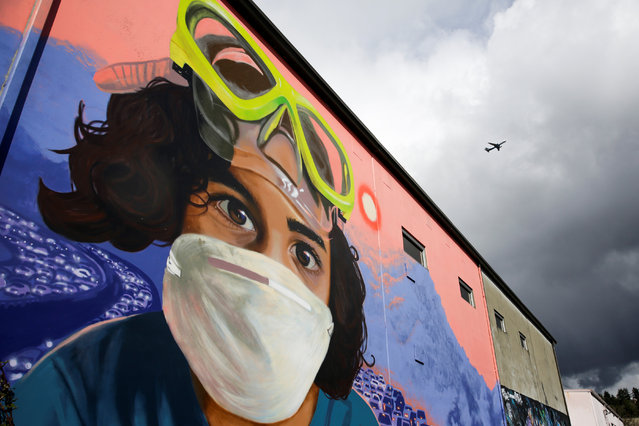 """The mural """"My Child, Our Air"""" by Craig Cundiff is pictured in Seattle's Georgetown neighbourhood as efforts continue to help slow the spread of coronavirus disease (COVID-19) in Seattle, Washington, U.S. March 24, 2020. (Photo by Jason Redmond/Reuters)"""
