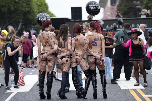Participants in the 3rd Annual Amber Rose SlutWalk in Los Angeles, California. October 1, 2017. The event seeks to highlight issues such as: gender equality, ending rape culture, victim blaming and body shaming. (Photo by Ronen Tivony/NurPhoto via Getty Images)