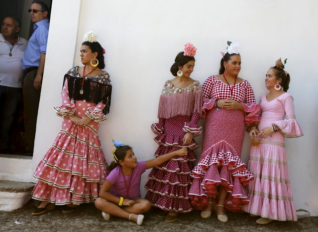 Pilgrims wearing traditional dresses take part during the Queen of Angeles pilgrimage in Alajar, southern Spain, September 8, 2015. (Photo by Marcelo del Pozo/Reuters)