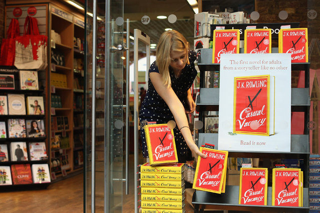 An employee at Foyles bookshop arranges copies of J. K. Rowling's latest novel 'The Casual Vacancy' which has gone on sale today starting at 8:00 am on September 27, 2012 in London, England.  'The Casual Vacancy' is J. K. Rowling's first book aimed at an adult readership and is centered on a parish council election in a small West Country town.  (Photo by Oli Scarff)