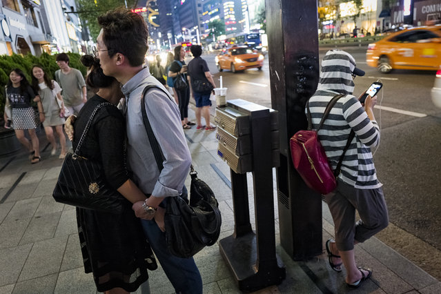 People are seen on a street of Gangnam station area on August 4, 2015 in Seoul, South Korea. A floating population of Gangnam station area is more than million per day. (Photo by Shin Woong-jae/The Washington Post)