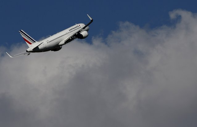 An Air France aircraft takes-off at the Charles-de-Gaulle airport, near Paris, September 16, 2014. A pilots strike at Air France entered its second day on Tuesday, with the two sides appearing no closer to resolving a dispute over cost cuts that has forced the airline to cancel 60 percent of flights. The pilots are carrying out a week-long strike over Air France's plans to expand the low-cost operations of its Transavia brand by setting up foreign bases as it seeks to fight back against fierce competition from budget carriers. (Photo by Christian Hartmann/Reuters)