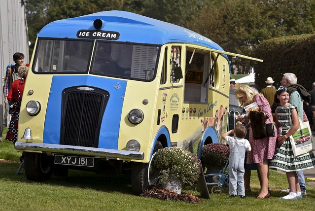 Visitors wait at an ice cream van during the Goodwood Revival historic motor racing festival in Goodwood, near Chichester in south England, Britain, September 11, 2015. (Photo by Toby Melville/Reuters)