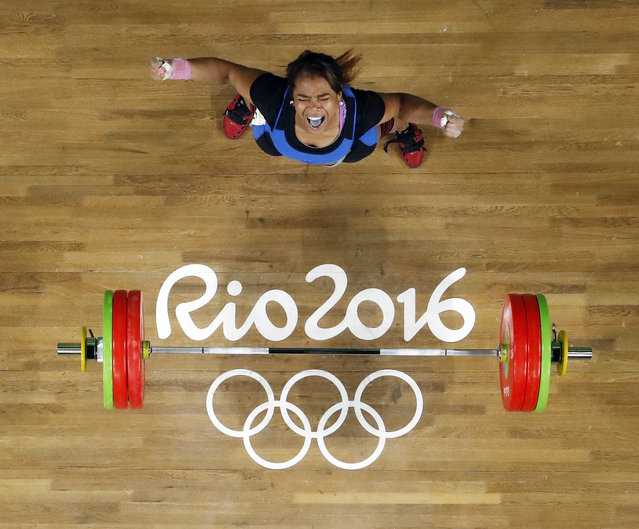 Leidy Yessenia Solis Arboleda, of Colombia, celebrates after a lift in the women's 69kg weightlifting competition at the 2016 Summer Olympics in Rio de Janeiro, Brazil, Wednesday, August 10, 2016. (Photo by Morry Gash/AP Photo)