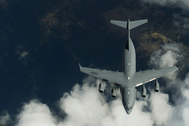 Members of the 191st Air Refueling Squadron conduct refueling operations with a C-17 Globemaster III from Joint Base Lewis-McCord, Wash. Airmen from the 191st ARS routinely support air operations across the western United States from their home station in Salt Lake City, Utah. (Photo by USAF)