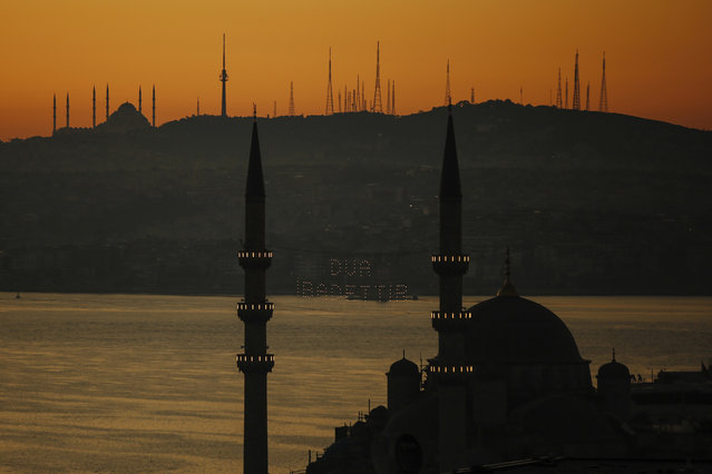 Mosques are seen as few masked people allowed to offer the Eid al-Fitr prayer amid concerns of the coronavirus outbreak at historical Suleymaniye Mosque, in Istanbul, early Sunday, May 24, 2020. Muslims in the world are marking a muted and gloomy religious festival of Eid al-Fitr, the end of the fasting month of Ramadan – a usually joyous three-day celebration that has been significantly toned down due to the new coronavirus outbreak. (Photo by Emrah Gurel/AP Photo)
