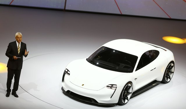 Porsche CEO Matthias Mueller presents the new electric Porsche Mission E concept car during the Volkswagen group night ahead of the Frankfurt Motor Show (IAA) in Frankfurt, Germany, September 14, 2015. (Photo by Kai Pfaffenbach/Reuters)