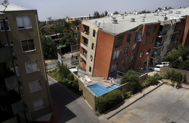 An apartment block leans over after an earthquake in Santiago February 27, 2010. (Photo by Marco Fredes/Reuters)