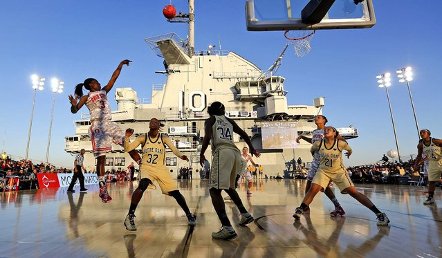 Ohio State's Amber Stokes shoots over Notre Dames's Jewell Loyd during the first half of an NCAA college basketball game in the Carrier Classic, onboard the USS Yorktown in Mount Pleasant, S.C., November 9, 2012 (Photo by Mic Smith/Associated Press)