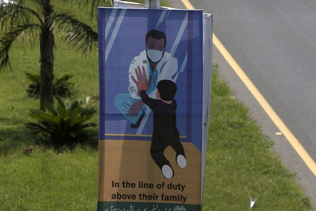 A banner paying tribute to doctors who are offering care and saving lives during the coronavirus pandemic is displayed on a highway in Islamabad, Pakistan, Monday, July 13, 2020. (Photo by Anjum Naveed/AP Photo)