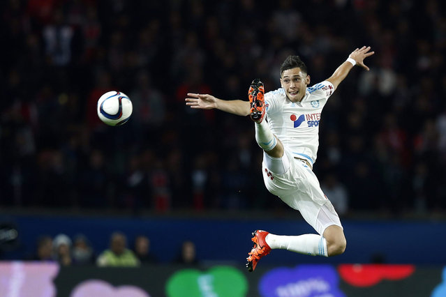Lucas Ocampos of Olympique de Marseille in action during the French League 1 soccer game opposing the Paris Saint Germain and the Olympique de Marseille at the Parc des Princes Stadium in Paris, France, 04 October 2015. (Photo by Etienne Laurent/EPA)