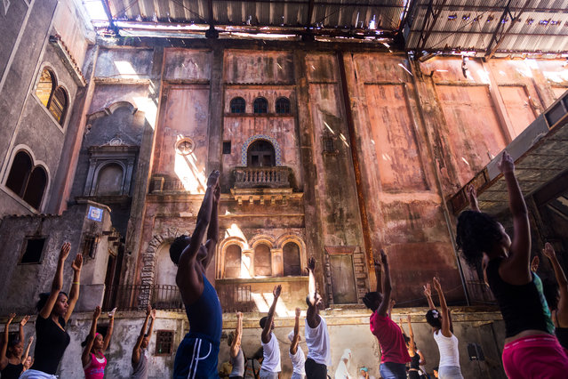 """Reach for the Stars"". This grand but weathered theatre in Havana, Cuba now serves as a dance studio for local dancers. The rough condition of the building is obscured by the obvious beauty behind the dust and the life and energy of the dancers within this space. Photo location: Havana, Cuba. (Photo and caption by Jerry Breaux/National Geographic Photo Contest)"