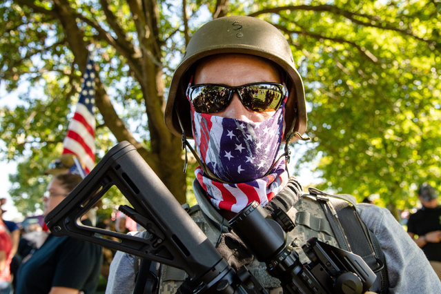 """Members of the Three Percenters and other militia armed with assault rifles attend the """"Patriot Gathering"""" in Cox Park during Derby Weekend on September 5, 2020 in Louisville, KY. (Photo by Amy Harris/Rex Features/Shutterstock)"""