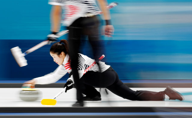 Jang Hye-ji and Lee Ki-jeong of South Korea compete during the Curling Mixed Doubles on day two of the PyeongChang 2018 Winter Olympic Games at Gangneung Curling Centre on February 11, 2018 in Gangneung, South Korea. (Photo by Cathal McNaughton/Reuters)
