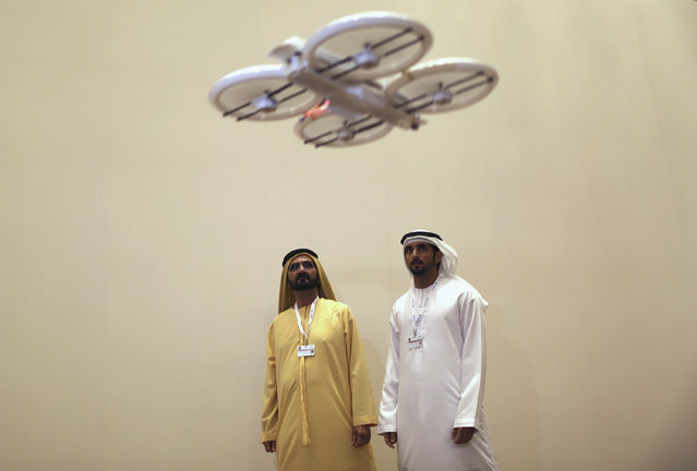 United Arab Emirates' Prime Minister and Ruler of Dubai Sheikh Mohammed bin Rashid al-Maktoum (L) and his son Dubai's Crown Prince Sheikh Hamdan bin Mohammed al-Maktoum watch an unmanned aerial drone during the Virtual Future Exhibition, in Dubai, February 9, 2014. (Photo by Ahmed Jadallah/Reuters)