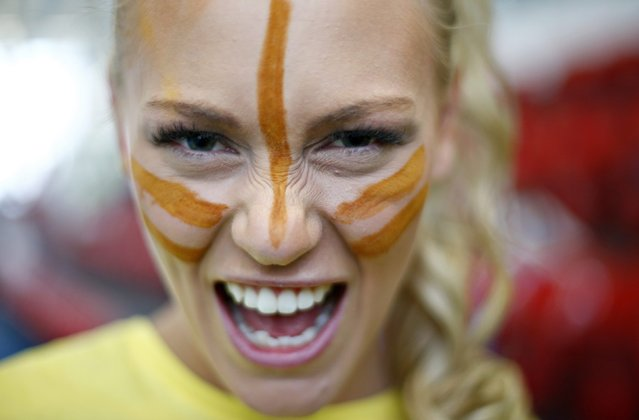 Miss Finland Krista Haapalainen wears face paint during the Miss World sports competition at the Lee Valley sports complex in north London, November 26, 2014. (Photo by Andrew Winning/Reuters)